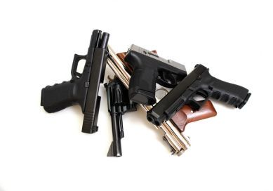 Black guns, Pistols and revolver isolated on a white background.